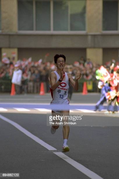 10th and final runner Takayuki Onaru of Chuo University crosses the finish tape to win the 72nd Hakone Ekiden on January 3 1996 in Tokyo Japan