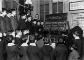 English lessons for Italian children at a school in Soho Signor de Villa instructs boys in reading and spelling