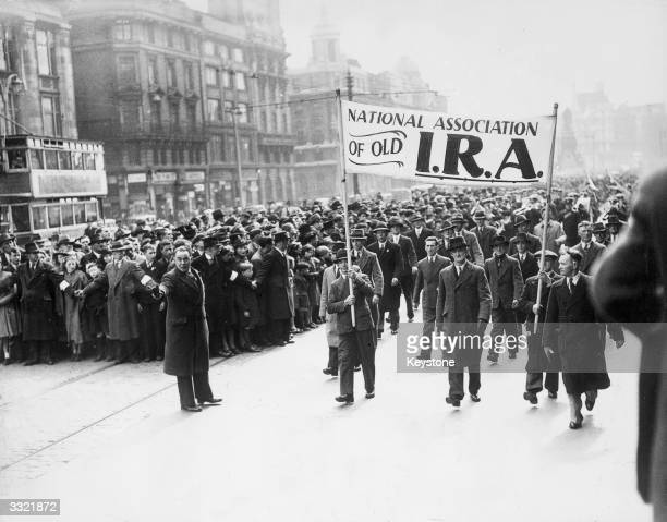 Crowds march through the streets of Dublin to commerate the Easter Rising the armed uprising of Irish nationalists against British rule in Ireland