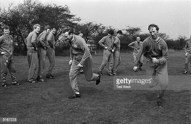 Don Revie the manager of Leeds Football Club puts English star Jack Charlton and the rest of the team through their paces prior to the FA Cup final...