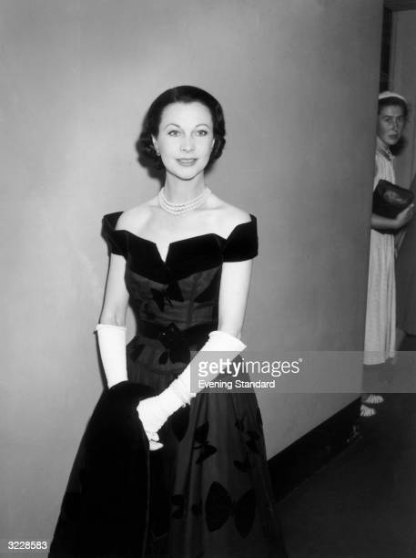 Stage and screen actress Vivien Leigh wearing an evening dress with a butterfly design
