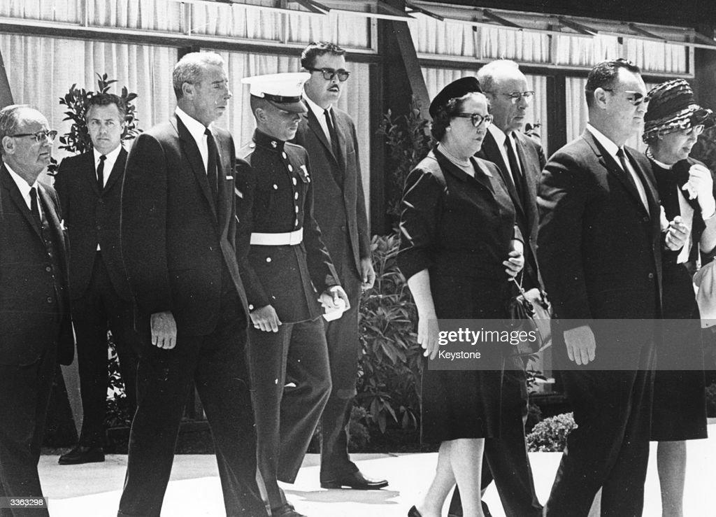 American baseball player Joe DiMaggio attends the funeral of film star Marilyn Monroe (1926 - 1962) with his son Joe Junior and Monroe's half-sister Bernice Miracle.