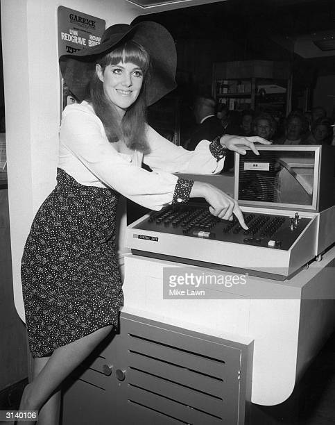 Actress Lynn Redgrave inaugurates the Computer Ticket Booking System at Swan and Edgar department store London She is appearing in 'The Two of Us' at...
