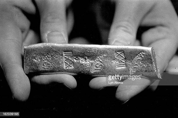 OCT 18 1987 10th Biannual Denver Coin 'Extravaganza' Sheraton Denver Tech Center Mike Dunigan hold a gold bar from the Atocha wreck found in 1985 by...
