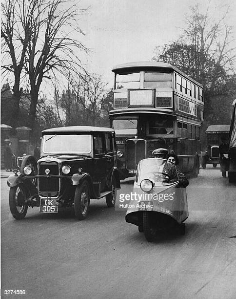 The Whitwood two wheel two seater car which reached a speed of 94 miles per hour during trialsand is seen here being road tested mongst other traffic...