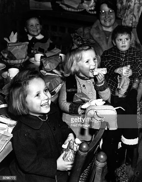 Children whose parents perished in Nazi concentration camps have a Christmas party at Berlin Various Berlin handicraft guilds made the children's...