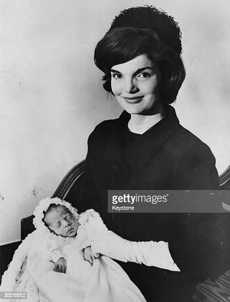 Jackie Kennedy the wife of the American PresidentElect John F Kennedy with her son John Kennedy Jr