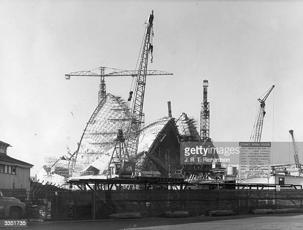 Construction of the shellshaped roof of the new opera house in Sydney harbour New South Wales Designed by Danish architect Jorn Utzon and completed...