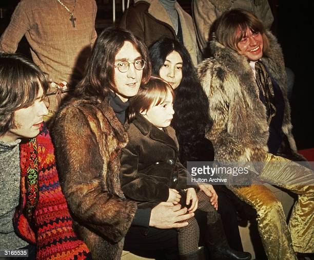 British musicians Eric Clapton John Lennon with his wife artist Yoko Ono and his son Julian and Brian Jones pictured at a press conference at...