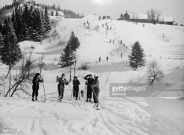 Skiers in the Canadian resort of the Laurentian Mountains forty miles north of Montreal