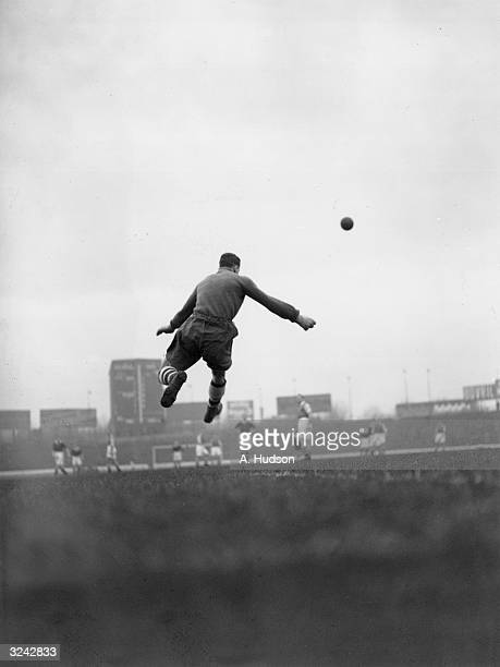 Arsenal goalkeeper George Swindin kicks the ball upfield during a match against Chelsea at Stamford Bridge London