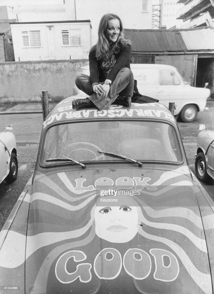 Yvonne Freeman of Southend, Essex, sitting atop her garishly painted Skoda, bearing the slogan 'Look Good'.