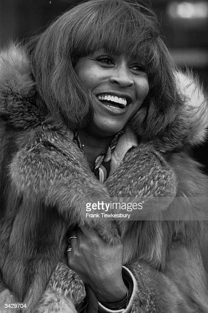 Rock star Tina Turner wrapped in furs as she arrives at Heathrow airport She is in the UK to give two concerts