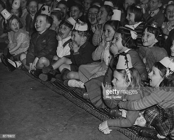 A group of children enjoy a pantomime at a party organised by the Mount Pleasant Post Office