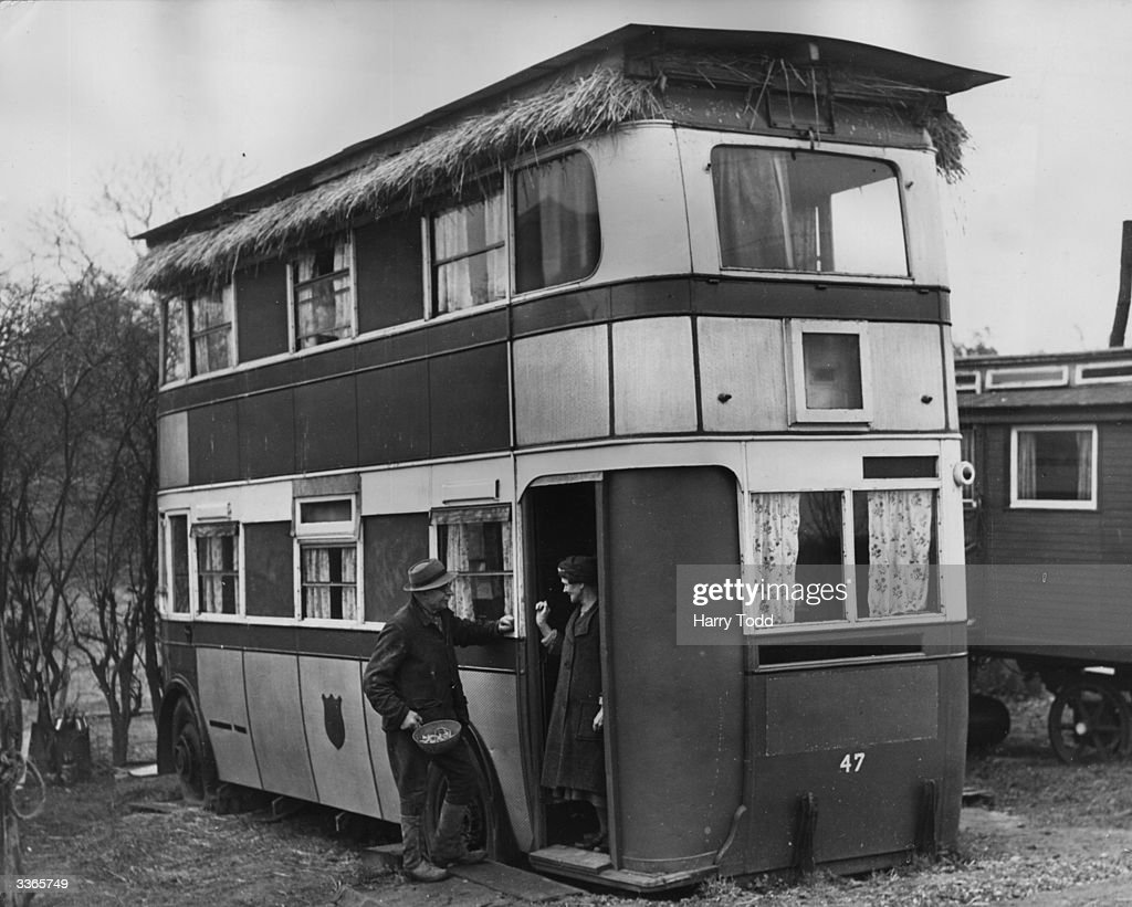 A converted trolley bus that used to service the streets of Ipswich, now the home of Mr and Mrs W Steward. Under planning regulations the bus would have to be moved on by the East Suffolk planning committee but Mr Steward has turned his bus into a 'cottage' by thatching the roof.