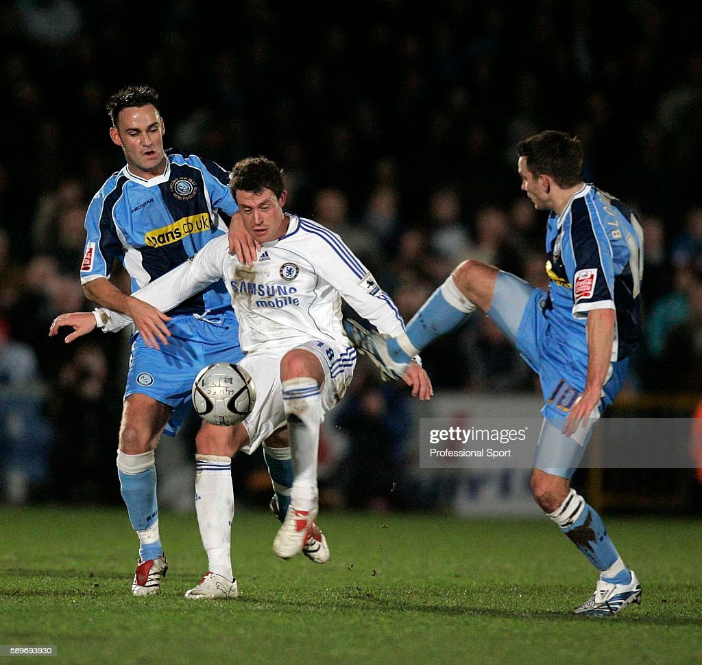 Stefan Oakes and Matt Bloomfield of Wycombe tussle with Chelsea goalscorer Wayne Bridge during the Carling Cup SemiFinal match between Wycombe...