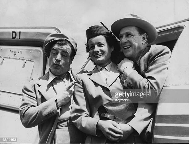 American comedy duo Bud Abbott and Lou Costello with an air hostess on their arrival at Orly Airport Paris