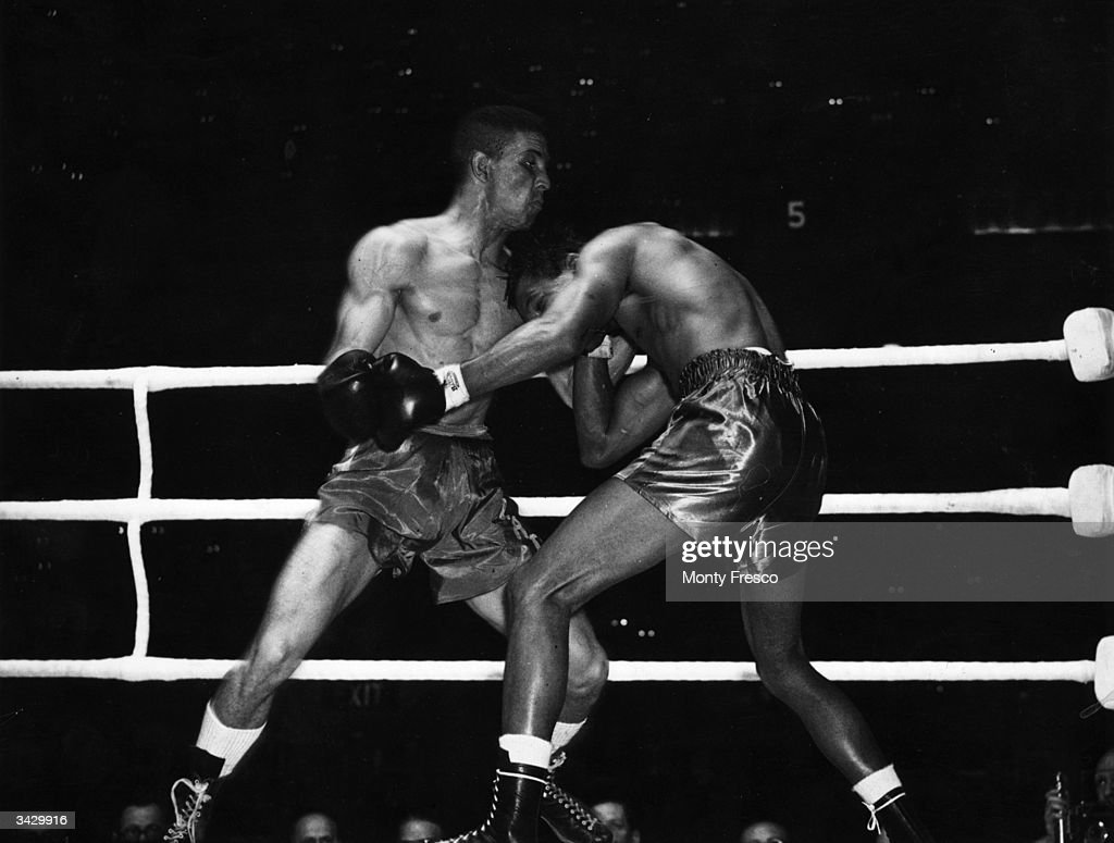 Sugar Ray Robinson and Randolph Turpin during their World Middleweight title fight which Turpin won on points