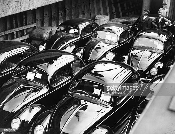 A consignment of brand new Volkswagen 'Beetle' cars arrive in London from Germany