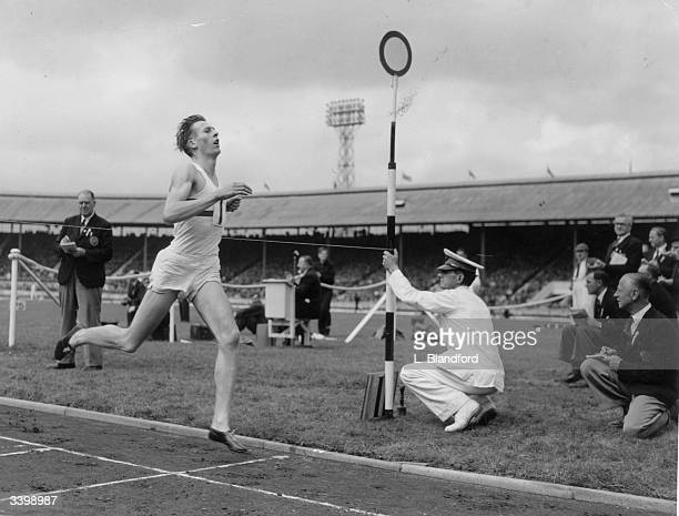 Roger Bannister winning the AAA Championships Mile race