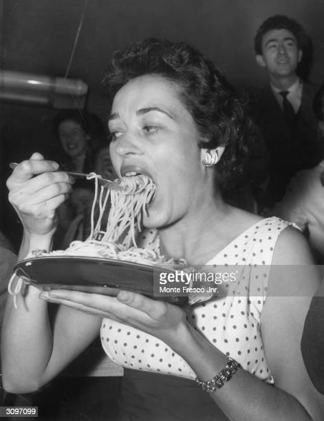 Pamela English of Maida Vale competes in a spaghetti eating contest at a restaurant in Frith Street Soho London
