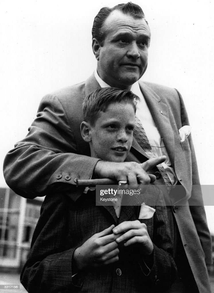 American comedian and actor Red Skelton with his son Richard on arrival in Copenhagen, the first stop on their family round-the-world trip. Richard is suffering from leukaemia and red planned the trip to give his son every possible happiness.