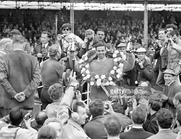 Scottish racing driver Jim Clark after winning the British grand prix at Silverstone