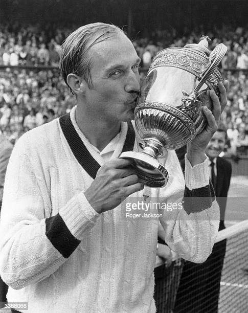 American tennis champion Stan Smith kisses the cup after beating Romania's Ilie Nastase to win the men's singles title at Wimbledon London