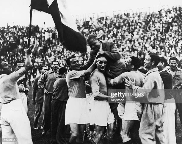 The Italian World Cup squad carry their manager Vittorio Pozzo shoulder high following their 21 victory over Czechoslovakia after extra time in the...