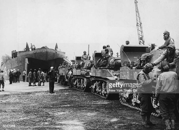 An armored tank unit of the US Army loads itself into a landing craft on their way to the beaches of France during the Allied invasion of mainland...