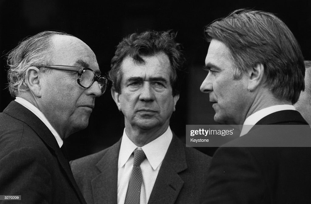 Roy Jenkins (1920 - 2003, left), Bill Rogers and Dr David Owen (right), all founder members of the SDP, talking together at the funeral of Lord George Brown.