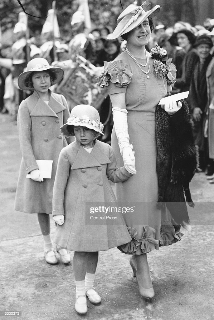 Elizabeth, Duchess of York with her daughters Princesses Elizabeth and Margaret Rose (1930 - 2002) arriving at Glamis Castle, Angus, to present Colours to the 4th and 5th Black Watch Regiments. The Duchess of York (now the Queen Mother) spent much of her childhood at Glamis Castle and Princess Margaret was born there in 1930.