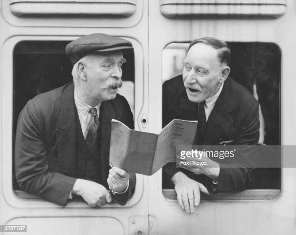 Two Welsh members of the Men's Choir of the Great Western Railway Institute practice their parts for the Railway Festival from the window of a rail...