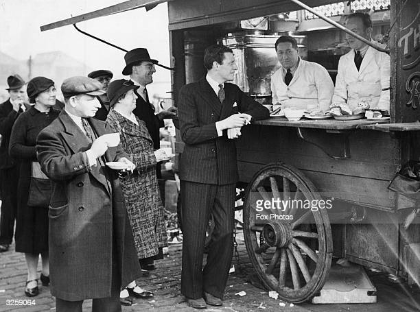 British actor Peter Murray Hill visits old friends at a coffee stall on Caledonian Market where he ran a bookstall before winning a contract with...