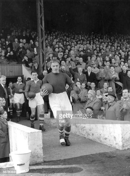 Sam Bartram receives a standing ovation from the Charlton faithful as captain for the day he leads his team out against Arsenal at the Valley ground...