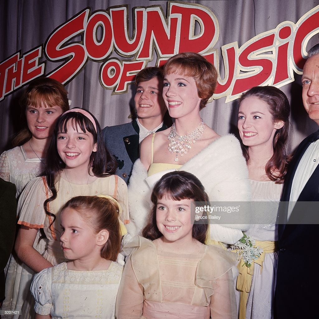 British actor and singer <a gi-track='captionPersonalityLinkClicked' href=/galleries/search?phrase=Julie+Andrews&family=editorial&specificpeople=93639 ng-click='$event.stopPropagation()'>Julie Andrews</a> poses with other cast members of director Robert Wise's film, 'The Sound of Music,' at the film's premiere, Hollywood, California,. L-R: <a gi-track='captionPersonalityLinkClicked' href=/galleries/search?phrase=Heather+Menzies&family=editorial&specificpeople=1660436 ng-click='$event.stopPropagation()'>Heather Menzies</a>, Angela Cartwright, <a gi-track='captionPersonalityLinkClicked' href=/galleries/search?phrase=Kym+Karath&family=editorial&specificpeople=1660437 ng-click='$event.stopPropagation()'>Kym Karath</a>, <a gi-track='captionPersonalityLinkClicked' href=/galleries/search?phrase=Nicholas+Hammond+-+Actor&family=editorial&specificpeople=1660432 ng-click='$event.stopPropagation()'>Nicholas Hammond</a>, Debbie Turner, Charmian Carr.