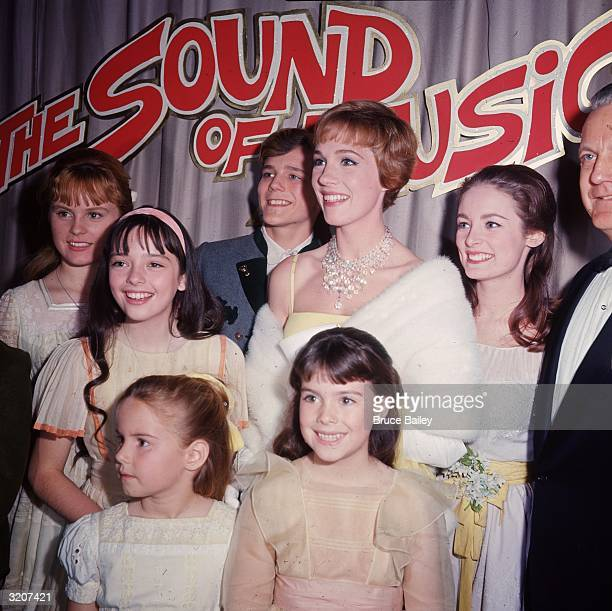British actor and singer Julie Andrews poses with other cast members of director Robert Wise's film 'The Sound of Music' at the film's premiere...