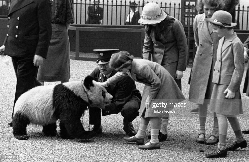 Princess Margaret Rose (1930 - 2002) and Queen Elizabeth II (as Princess Elizabeth) enjoy a visit to the zoo.