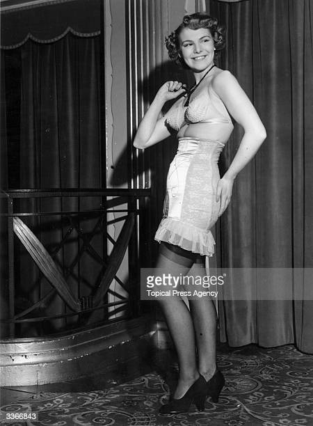 A model shows off an Aurore tulle brassiere and girdle at a fashion display of corsetry underwear and nightwear at the Park Lane Hotel in London