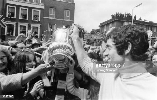 Fans mob Frank McLintock and the Arsenal team as they parade through Highbury with the FA Cup Arsenal won the trophy with a 21 victory over Liverpool...