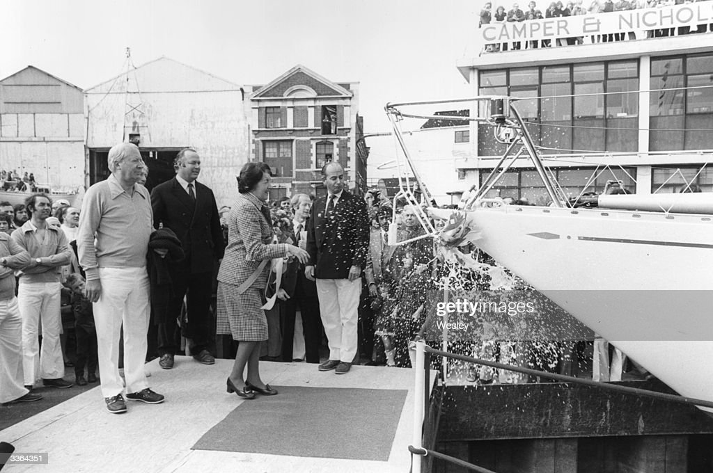 Mary Heath, the step-mother of former Prime Minister Edward Heath (left), launches his yacht 'New Morning Cloud', at the Camper and Nicholson boatyard at Gosport, Hampshire, England.