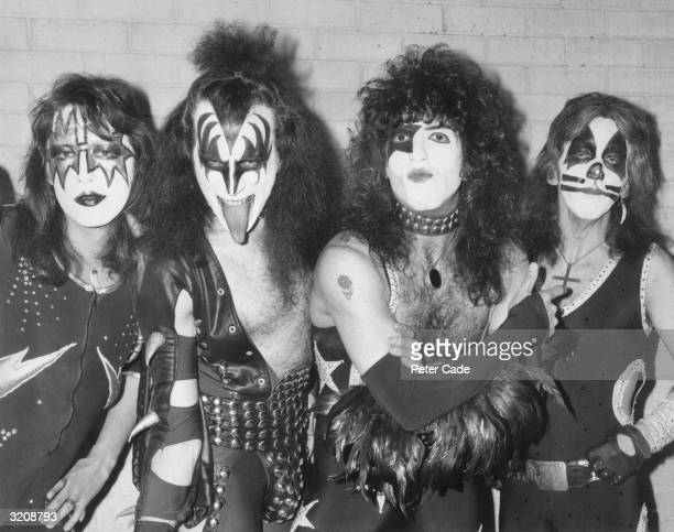 American rock group Kiss arrive at London airport for their first European tour already sporting black and silver make up and costumes From left to...