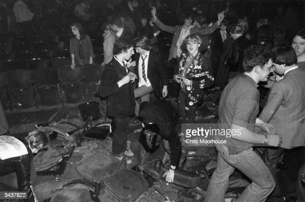 Punk rock fans destroying the Rainbow after the Clash and the Jam had played there during the 'White Riot' tour