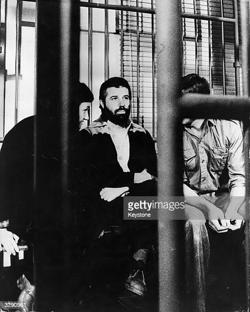 Renato Curcio leader of the Italian leftwing terrorist group the Red Brigade behind bars during his trial in Turin
