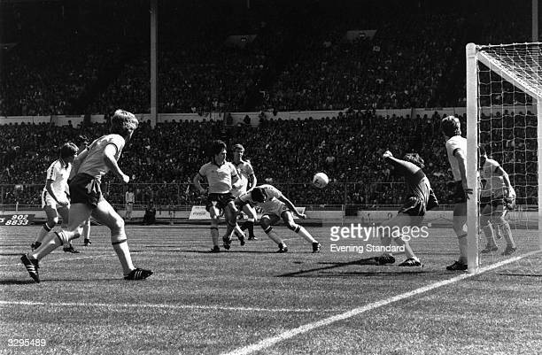 West Ham United's Trevor Brooking stoops low to head in the winning goal against Arsenal in the FA Cup Final at Wembley The final score is West Ham 1...