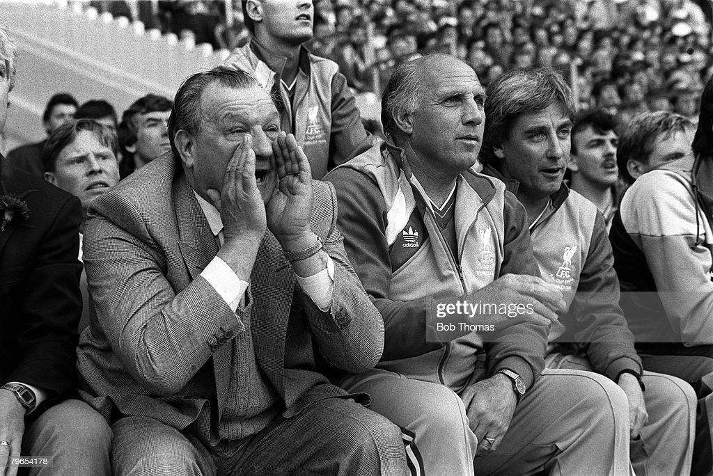 10th May 1986, Wembley Stadium, London, FA Cup Final, Liverpool 3 v Everton 1, Former Liverpool Manager Bob Paisley shouts instructions to his players; sitting next to him are his backroom staff Ronnie Moran (1934-2017) and Roy Evans