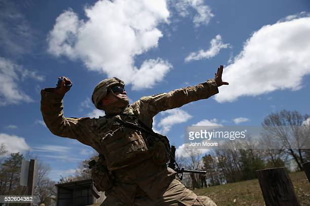 A 10th Mountain Division soldier throws an unarmed hand grenade during a training exercise for future conflicts on May 18 2016 at Fort Drum New York...
