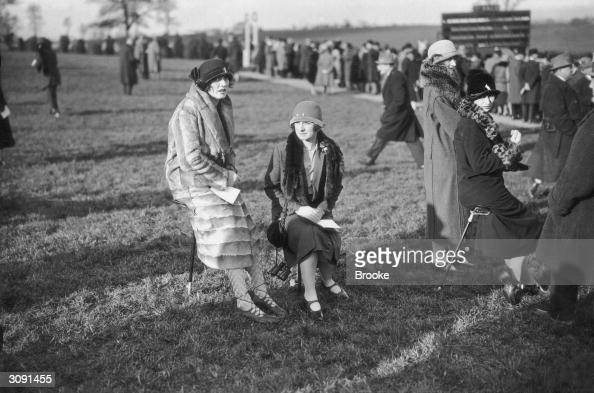 Mrs G S L Whitelaw and Mrs H C Deacon in the paddock at the Cheltenham races