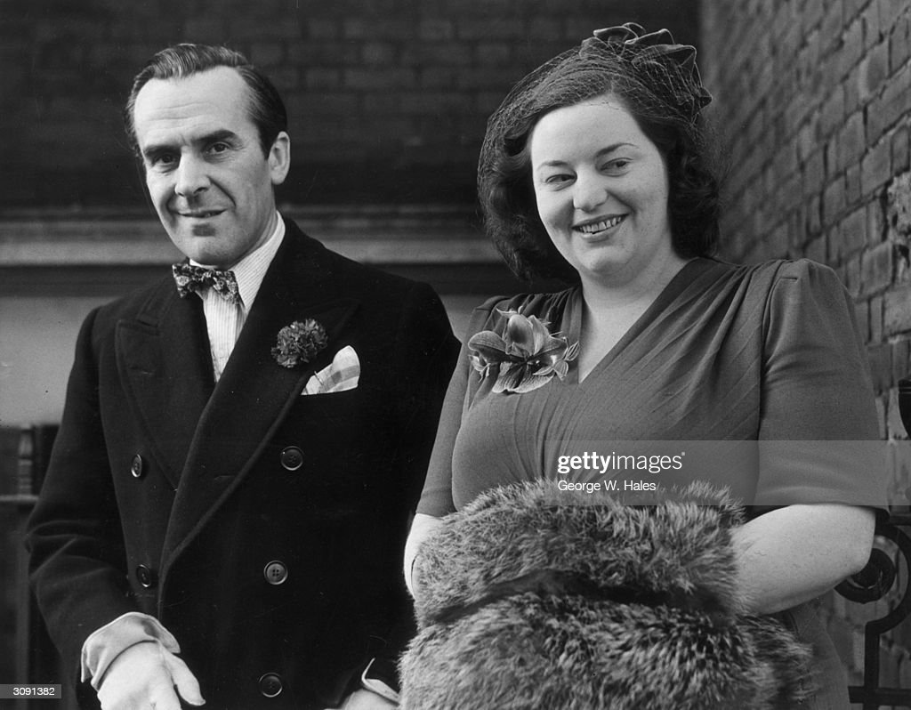 Actor John Le Mesurier (1912 - 1983) and actress Hattie Jacques (1924 - 1980) leaving the registry office, Kensington, London, after their wedding ceremony.