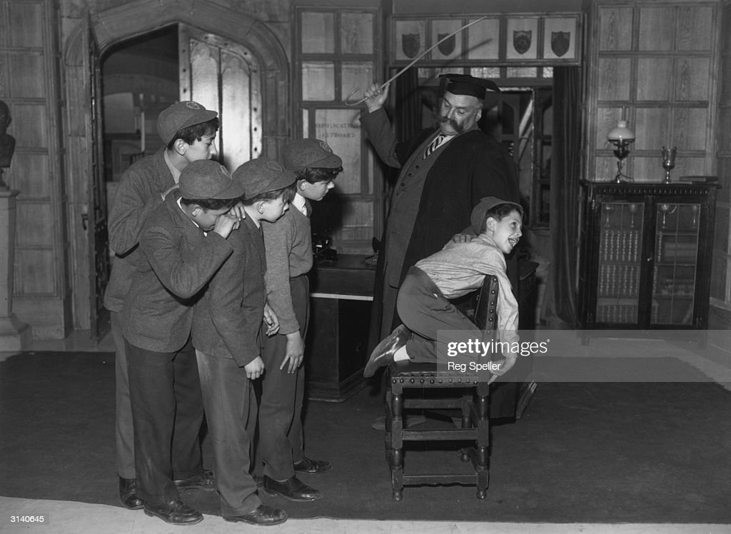 'Professor' Jimmy Edwards in rehearsal at Shepherds Bush TV studios is administering a flogging to one of the pupils of 'Chiselbury' school Paul...